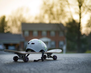 Skateboard and helmet in suburban neighbourhood